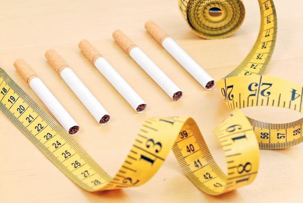 сигареты и сантиметр