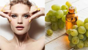 девушка держится за лицо, виноград и его масло